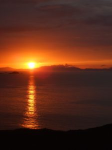 Aird Cottage :: Sunset over Uists from Duntulm