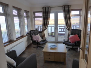 Aird Cottage :: Long view of the sun lounge